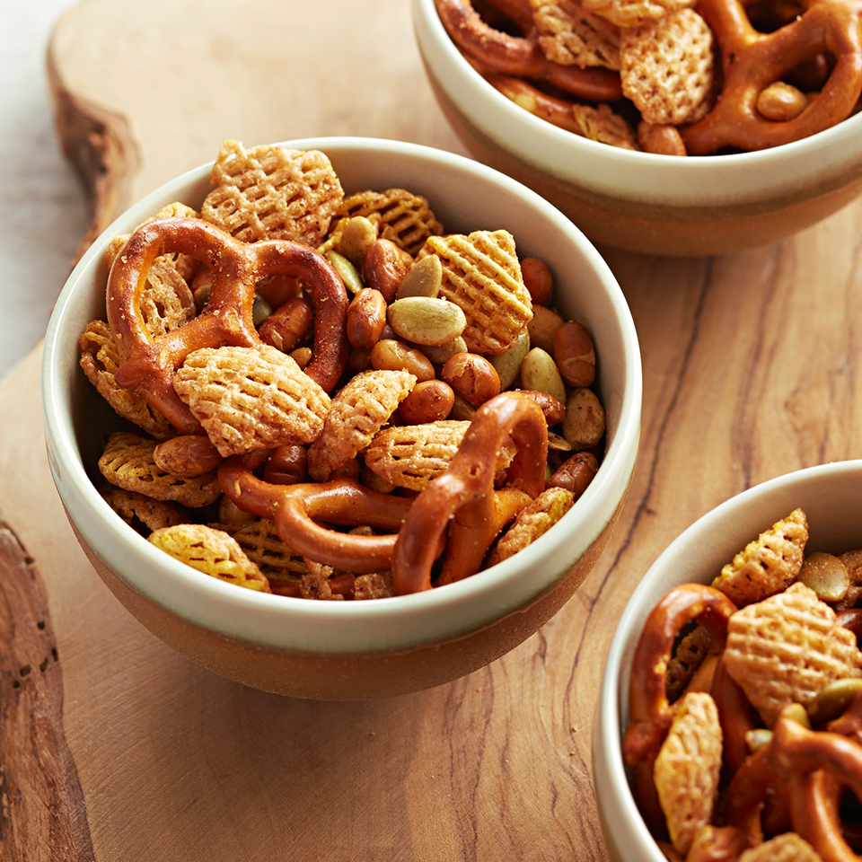 With both sweet and spicy flavors to entice your taste buds, this slow-cooker-prepared snack mix is easy to make and great to have on hand for game days, parties, and after-school snacking. Remember to stir it every so often, as directed, to keep things from sticking together.