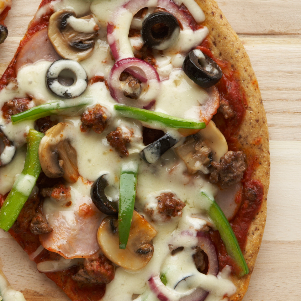 This whole-grain pizza has everything on it--sauce, beef, bacon, veggies, olives, and cheese. Feel free to substitute different types of meat or vegetables to suit your taste. Source: Diabetic Living Magazine