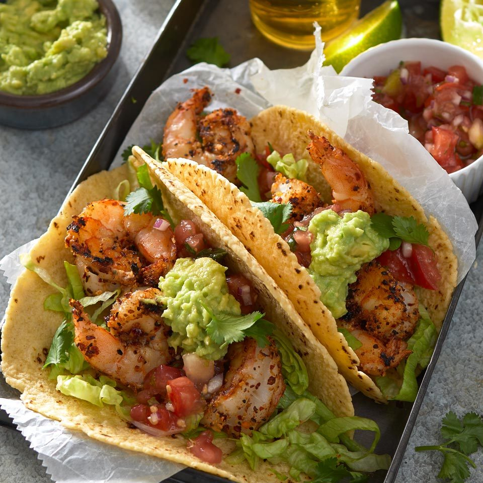 Give juicy shrimp tacos a Cajun flavor spin with spices and a quick sear on a hot grill. An easy avocado mash adds creaminess to cool off the spicy kick. Source: EatingWell.com, January 2019
