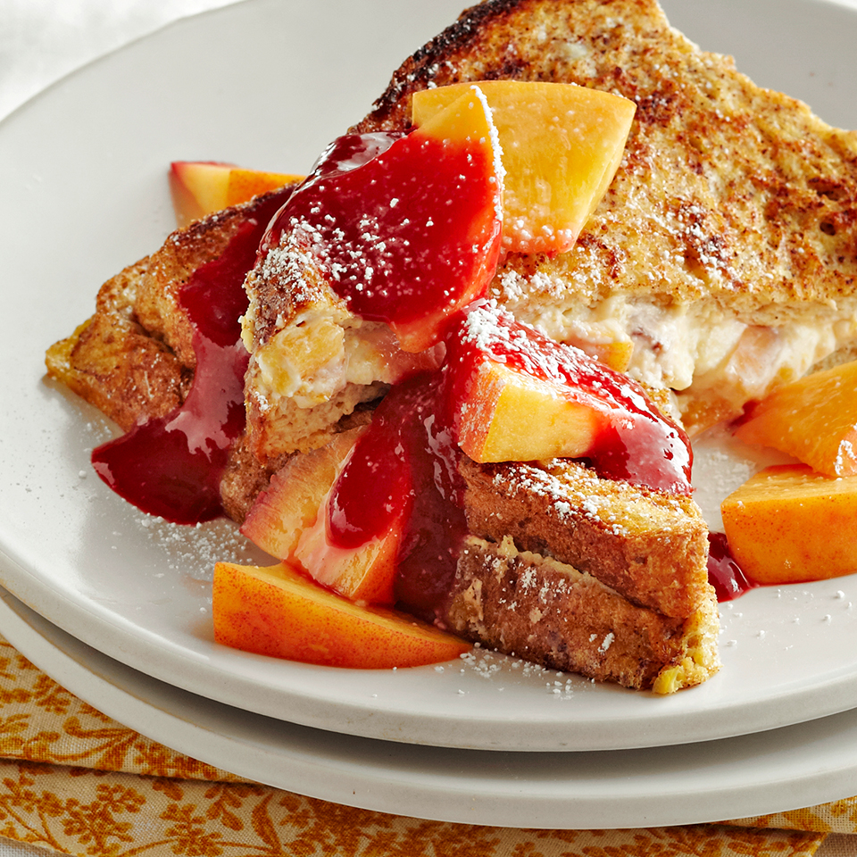 Overnight French toast recipes are easy to prepare and a great choice when you have houseguests who'll want a hearty and special breakfast in the morning. This recipe is extra-special because the French toast is stuffed with a cream cheese and raspberry filling which becomes an ooey-gooey treat in each bite. Topped with a raspberry sauce, fresh peaches, and powdered sugar, this breakfast recipe will be a hit with everyone at your table. Source: Diabetic Living Magazine