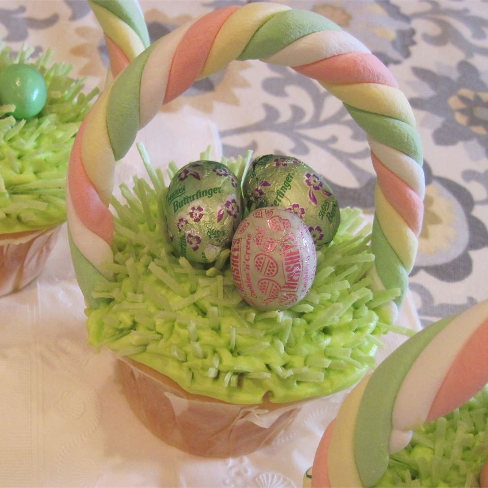 "These adorable Easter basket cupcakes feature a surprise center! ""White cupcakes with a chocolate Easter egg in the center, thick, colorful icing, and topped with a chocolate mini egg,"" says Keara Marshall. ""Great Easter treat!!"""