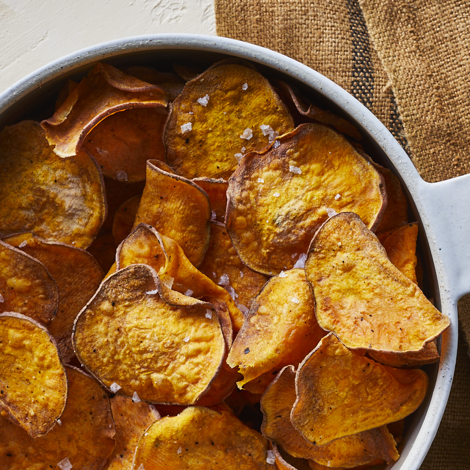 Thinly sliced sweet potatoes fry to a crispy crunch in the air fryer. These homemade chips also use much less oil, which cuts down on calories and fat. They're a naturally sweet side for sandwiches, burgers, wraps and more.