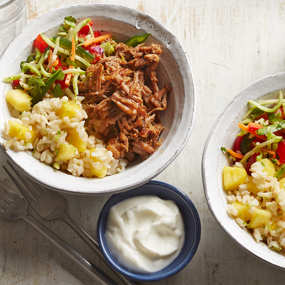 This burrito recipe may lack a tortilla but it doesn't lack anything in taste. Spicy shredded pork, crisp and vibrant veggie slaw, and warm pineapple-lime rice combine to deliver a beautiful presentation in your bowl.