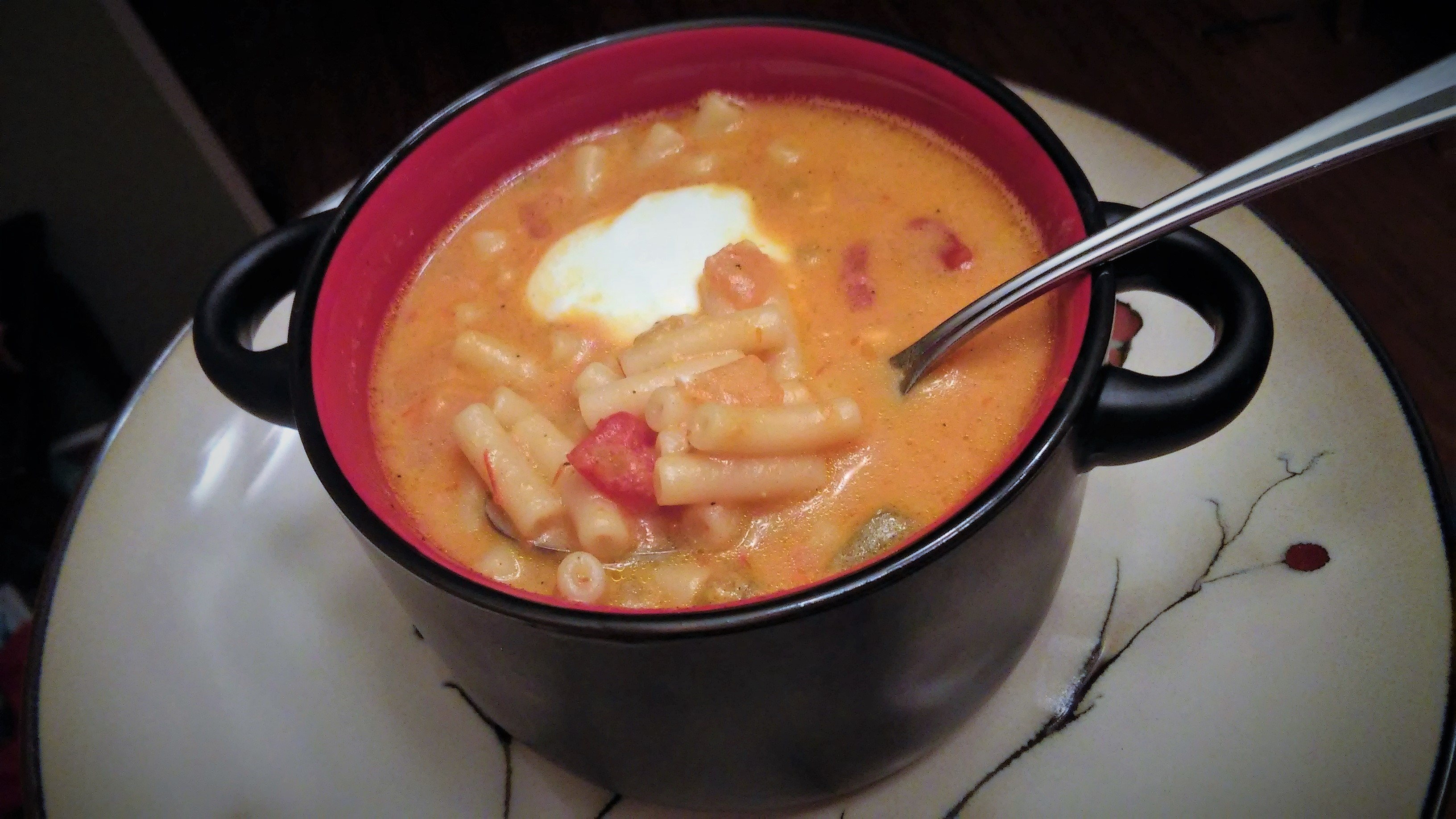 "With this recipe, you'll always have time to whip up a quick dinner. A couple of boxes of mac and cheese magically transforms into a tasty soup. Melissa Goff says, ""This was a great way to use up pantry items...my family dug into it before I pulled out the sour cream. Even hubby had some and didn't say nothing about the tomatoes in it."""