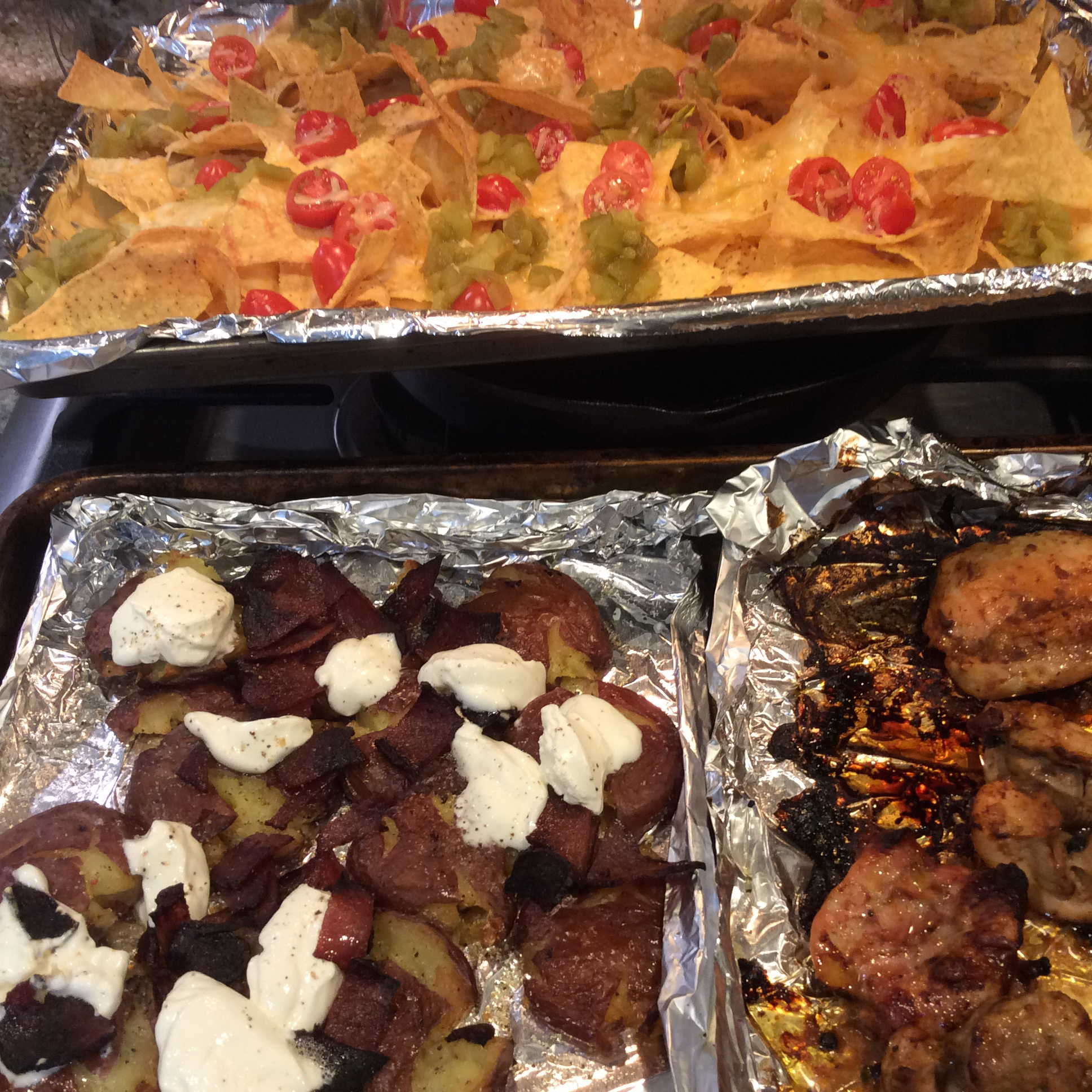 Sheet Pan Nachos, Sticky Sesame Ginger Wings, and Smashed Loaded Potatoes from Reynolds Wrap® andrea