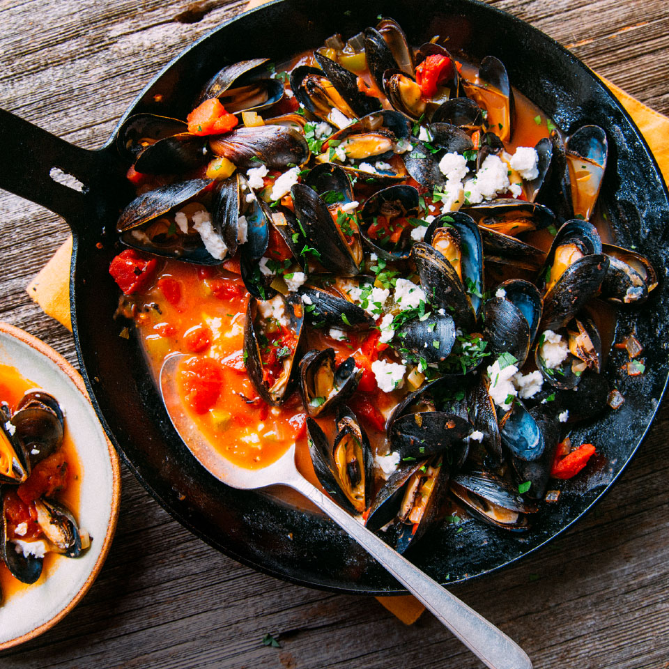 "This simple and delicious mussels recipe is restaurant-worthy. Just make sure you clean your mussels well before cooking: Give them a rinse under cold running water and use a brush to remove any barnacles or grit from the shell. Discard mussels with broken shells or those whose shells remain open after you tap them lightly. Pull off any fibrous ""beard"" that may be pinched between the shells. Source: EatingWell Magazine, March 2019"