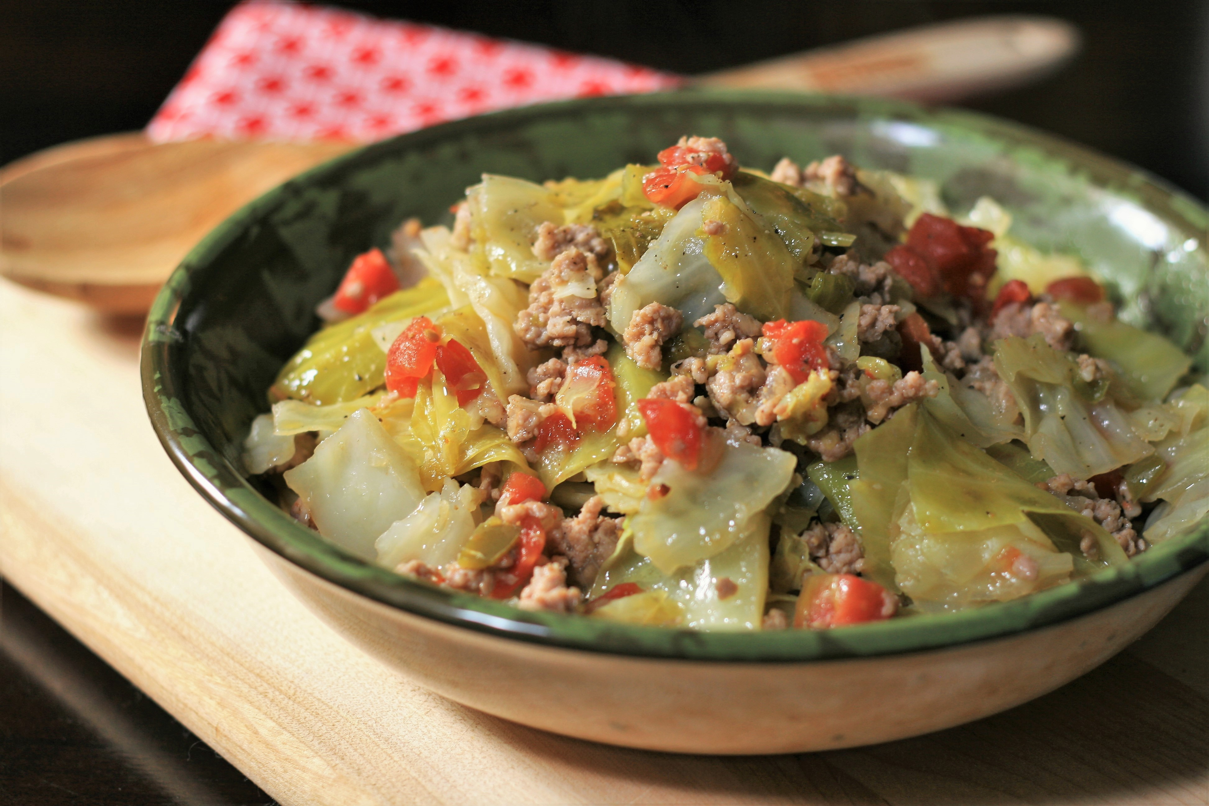 """Ready in 40 Minutes. This hearty, one-pot meal combines Creole-seasoned ground pork (or beef) with garlic, onions, green peppers, diced tomatoes with green chile peppers, and a whole head of roughly chopped cabbage. """"Perfectly seasoned with just a hint of heat,"""" says France C. """"A great one pot meal for a busy night!"""