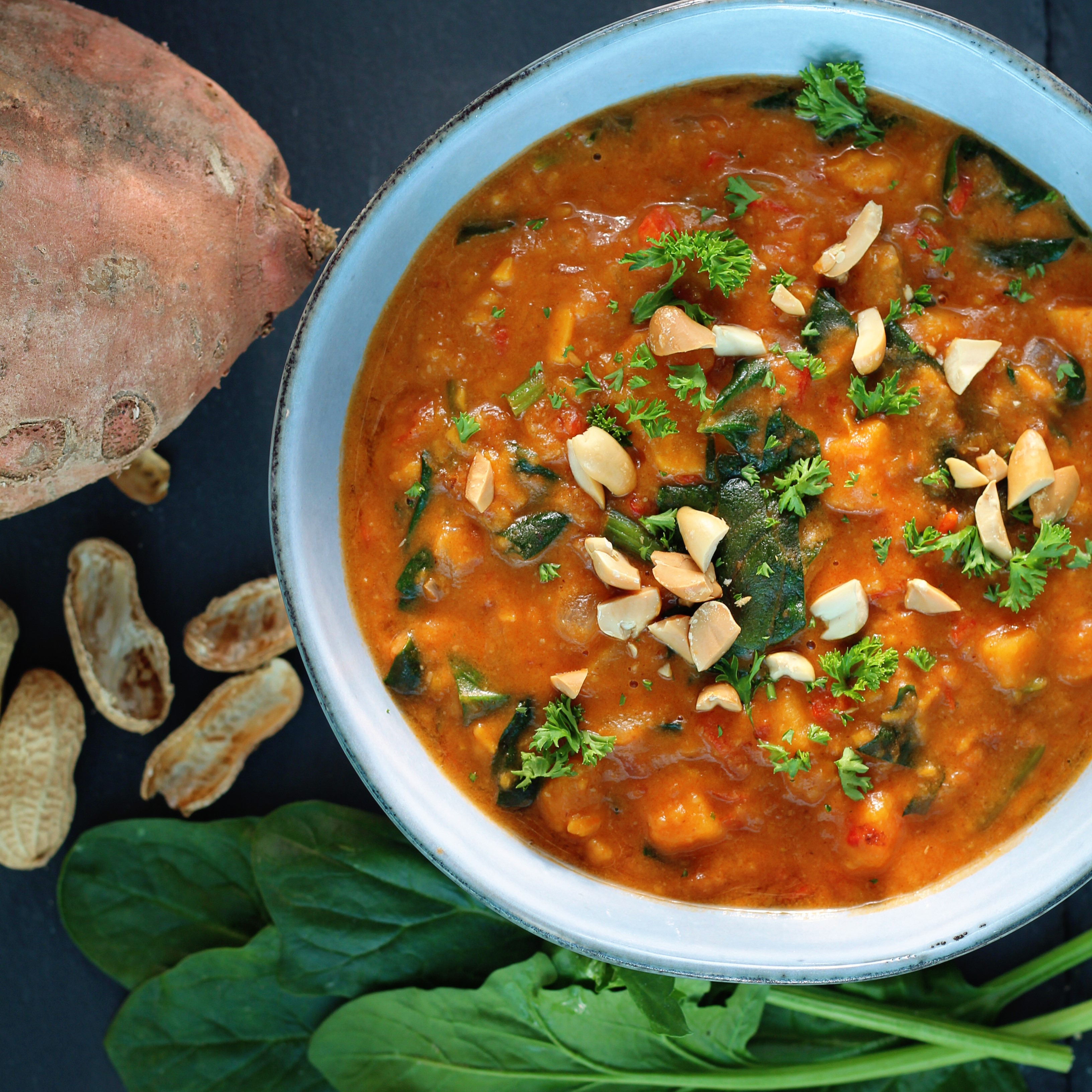 "Loaded up with sweet potatoes, diced tomatoes, red bell peppers, and collard greens, the simple stew is clean, vegan, and ready in no time. ""One of my go-to favorites; hubby would eat it weekly, and he's not vegan,"" says Dea. Enjoy it topped with cilantro and chopped peanuts."