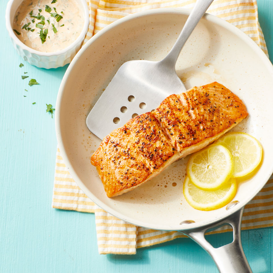 Paprika and garlic powder make a quick Cajun-inspired seasoning that flavors salmon fillets in this easy dinner recipe. Traditionally, remoulade sauce is prepared with mayonnaise; here, we substitute nonfat Greek yogurt for a lighter version. Source: Diabetic Living Magazine, Spring 2019