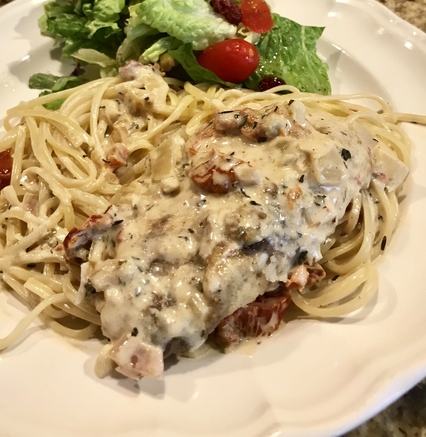 """""""This meal served with an intriguing cream sauce is actually an easy dish for beginners to prepare,"""" says kelly. """"It tastes like it came from a restaurant!"""" The cream sauce features shallot and garlic, a touch of vodka, lemon and lime juice, fish sauce, sun-dried tomatoes, fennel seeds, basil, thyme, and Worcestershire sauce."""