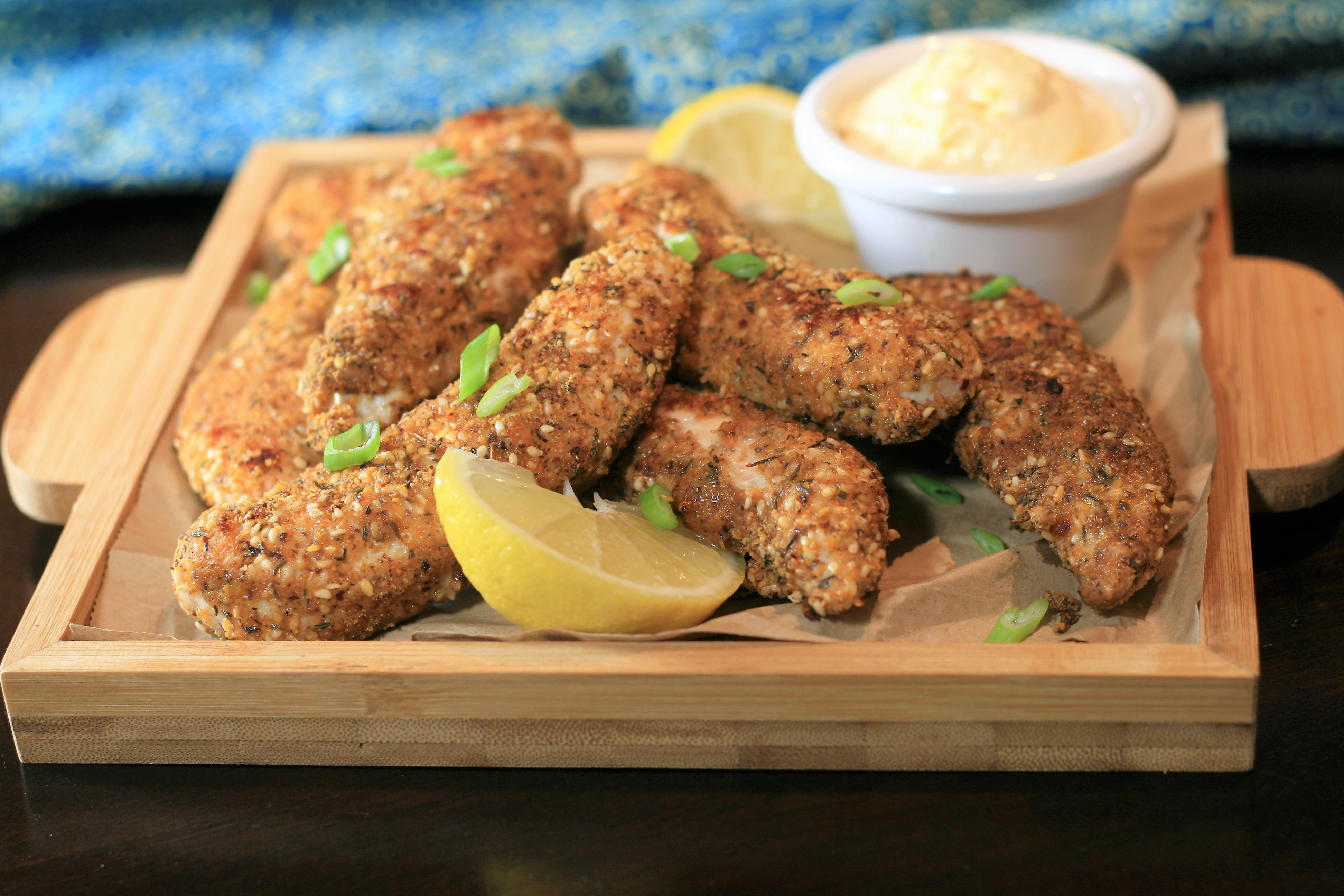 """These chicken tenders are loaded with Middle Eastern flavors,"" says France C, including minced preserved lemon peel. ""Dukkah, a spice blend made with hazelnuts, seeds and spices, is becoming increasingly popular and available in ethnic markets, spice shops, and farmers' markets. Make the aioli ahead of time for best flavor."""