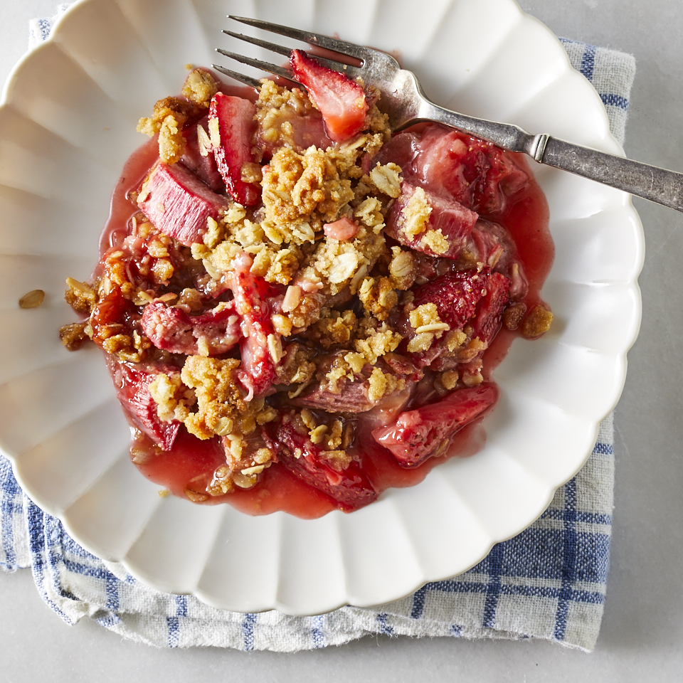 Tart rhubarb and sweet strawberries turn tender in their own juices beneath a brown sugar and oat crumble topping. This spring-inspired dessert comes together quickly without pie crusts to unroll; the tender fruit cooks quickly to make this a great last-minute dessert option too. Serve warm for the most luscious texture. Source: EatingWell.com, February 2019