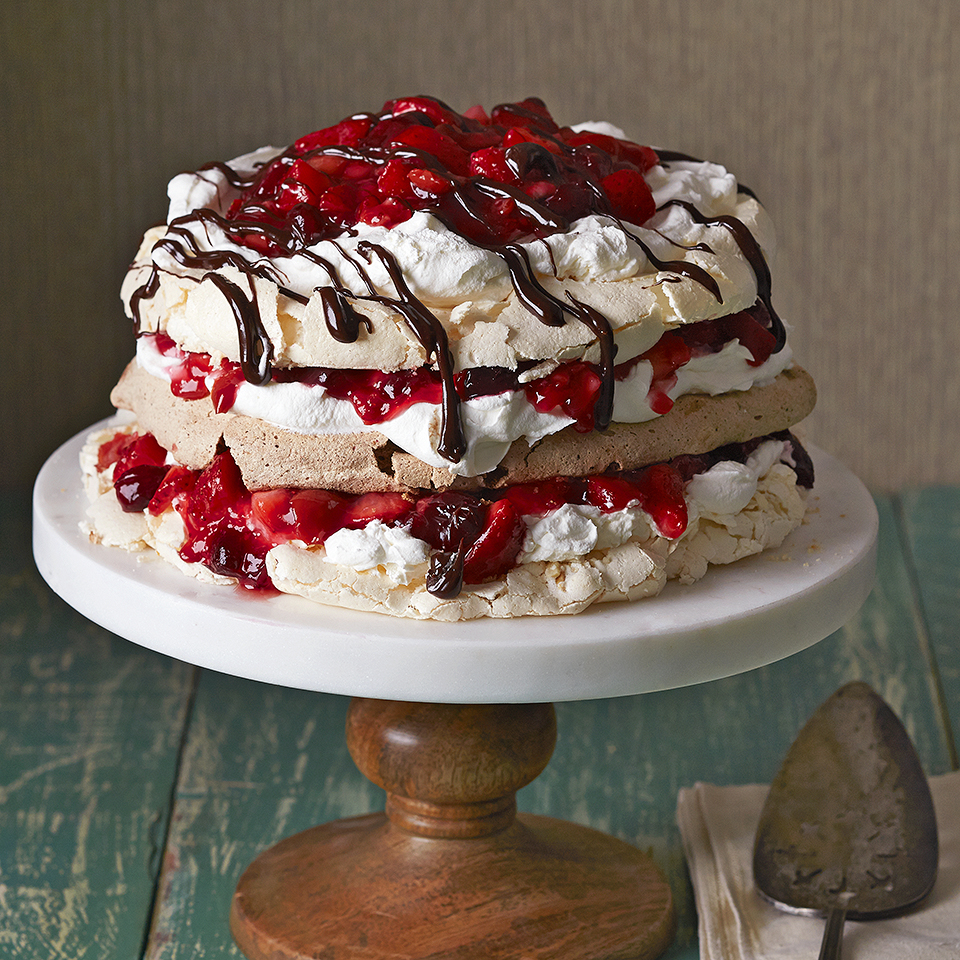 Wow your dinner guests with this beautiful stacked meringue dessert drizzled with a delicious chocolate sauce. Each slightly different meringue layer is layered with an orange-mascarpone cream and a fruity sauce of cranberries, cherries, and strawberries--presenting a stunning visual for any special occasion. Source: Diabetic Living Magazine