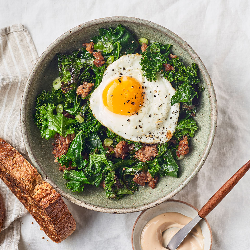 This breakfast-for-dinner fried egg skillet is a no-brainer alternative to takeout when you're rushed. The sausage and dark leafy greens are cooked in the same pan as the eggs, so cleanup is a cinch. Loading kale into this quick dinner recipe provides some calcium as well as vitamins and fiber. Serve with whole-grain toast and simple tomato aioli for a weeknight dinner that's ready in 20 minutes. Source: EatingWell Magazine, April 2019