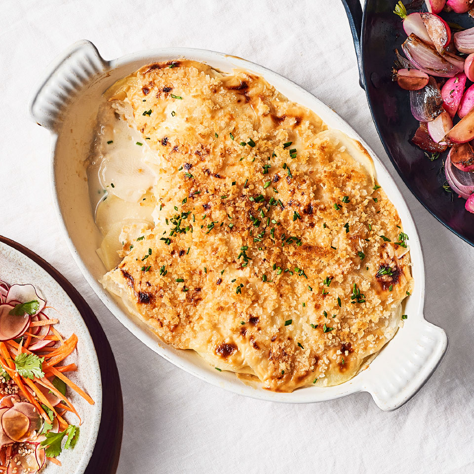 Adding daikon radish to this cheesy potato gratin boosts flavor and trims calories. To make this a quick recipe, we precook the vegetables before topping them with Gruyère cheese sauce and panko, then run the gratin under the broiler to create a delicious golden-brown crust.