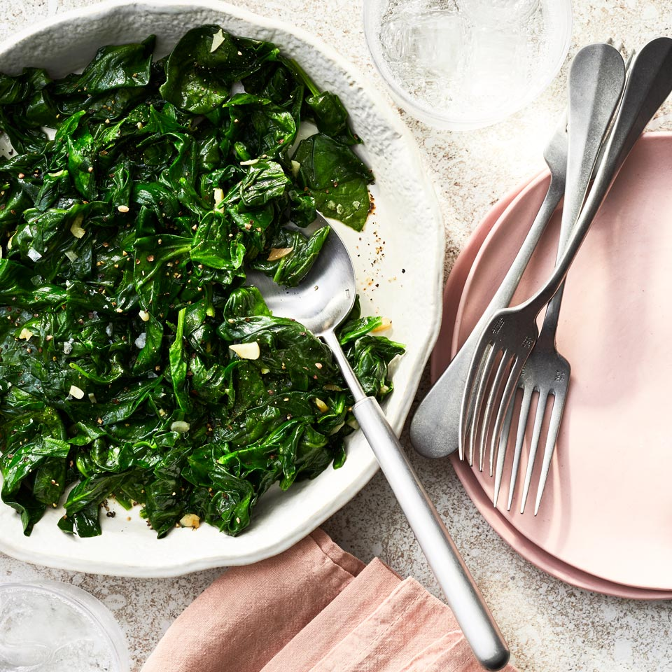 To make this easy wilted spinach recipe, simply give spinach a quick toss in hot, garlicky oil for the perfect quick and easy side dish for salmon, chicken or just about any main course. This versatile dish is ready in just 10 minutes so it's a cinch for weeknight dinners.