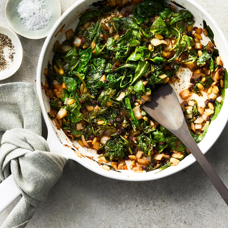 In this quick and easy sautéed spinach recipe, a handful of standard pantry items transform frozen spinach into a satisfying side dish or omelet filling. Source: EatingWell Magazine, October 1997