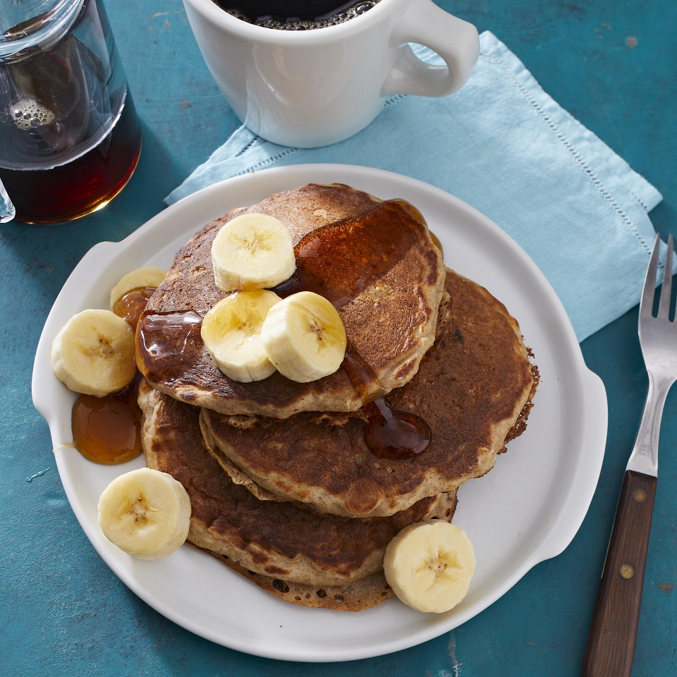Start your day in a hearty, high-grain way with these buttermilk-oatmeal pancakes. Maple syrup is a perennial favorite atop a stack of these pancakes; sliced bananas would also complement their oat flavor.