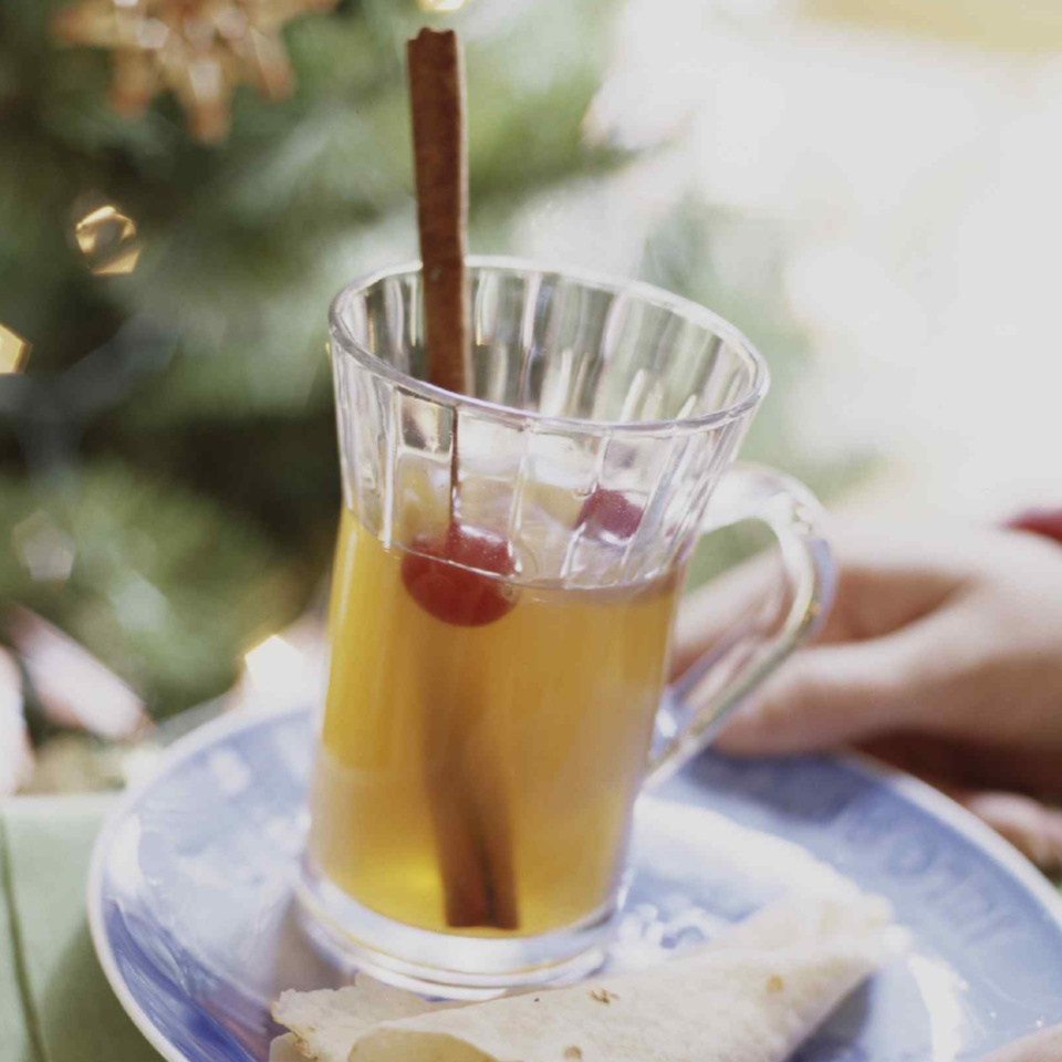 Chai tea and fruit juices make this festive hot drink a must-serve at your next holiday gathering.