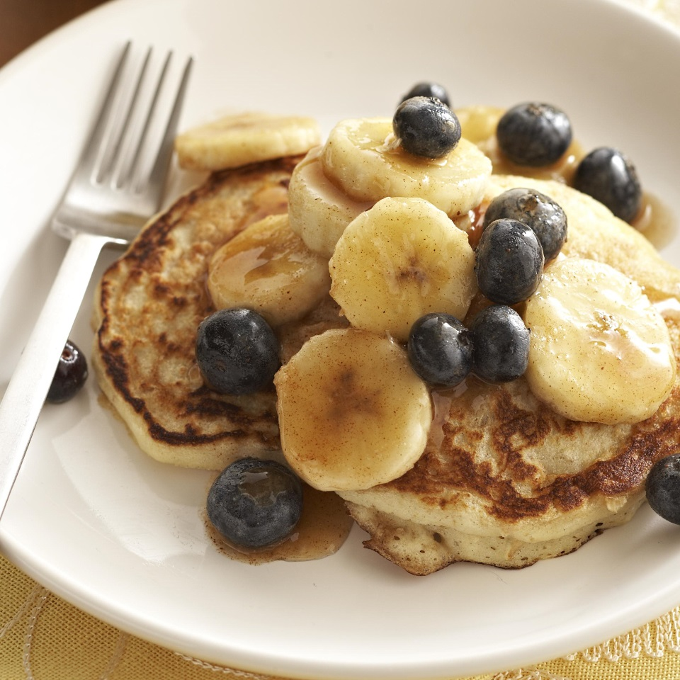 Perfect for a lazy weekend breakfast, these buttermilk pancakes are taken to new heights with a banana and blueberry maple syrup topping. Source: Diabetic Living Magazine