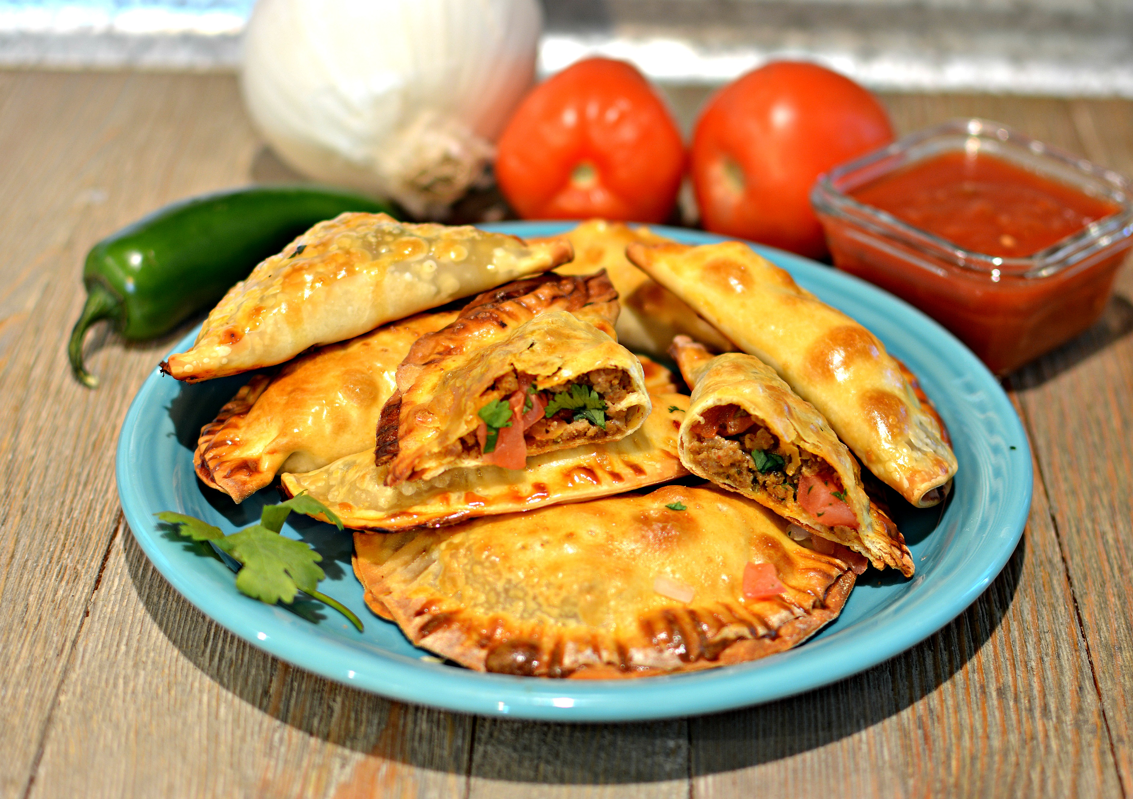 """Half taco, half calzone, all convenience. """"These taco pies are easier to handle than regular tacos you need two hands to keep the the shells from cracking and the fillings from falling out,"""" says bd.weld. """"Pico de gallo and pepper Jack cheese round out the flavors of the taco beef. Serve with picante sauce for dipping."""""""