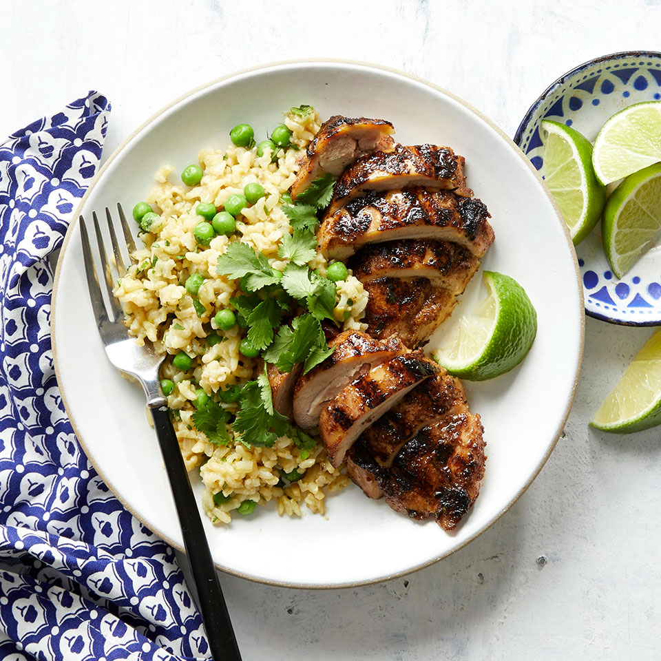 Add some flavor of the Caribbean to your weeknight dinners with this healthy and easy jerk chicken recipe. The chicken is cooked on a grill pan rather than an outdoor grill--make sure the pan is well-heated before adding the chicken to achieve the crisp char you would get from an outdoor grill. A simple side of coconut rice and peas completes this satisfying and nutritious meal. Source: EatingWell Magazine, May 2019