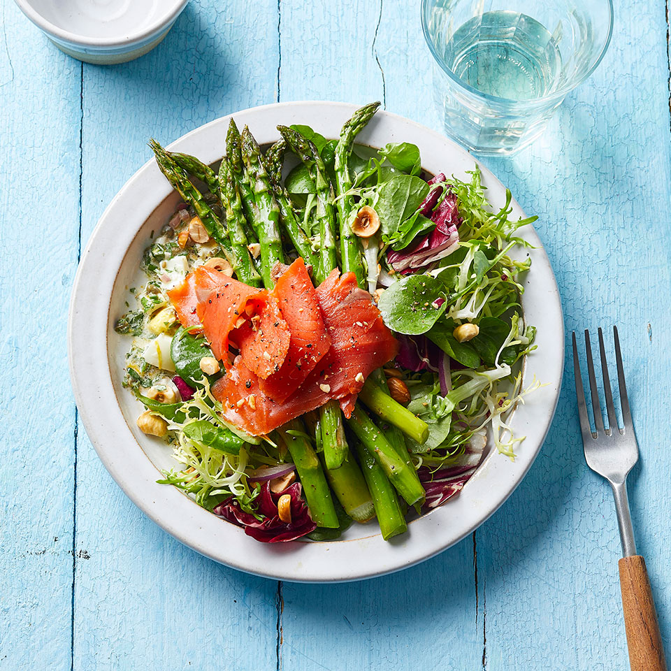 The big punch of this healthy salad with asparagus and smoked salmon comes from gribiche, a creamy French herb sauce with chopped egg. The greens get a toss in a vinaigrette made floral with Meyer lemon. Can't find a Meyer lemon? Substitute with regular lemon. Source: EatingWell Magazine, May 2019