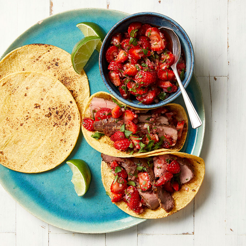 For this easy taco recipe, we've topped skillet-cooked flank steak with a quick fresh salsa that takes advantage of perfectly ripe strawberries. Make the salsa while the steak cooks for a 30-minute dinner the whole family will love. Source: EatingWell Magazine, May 2019