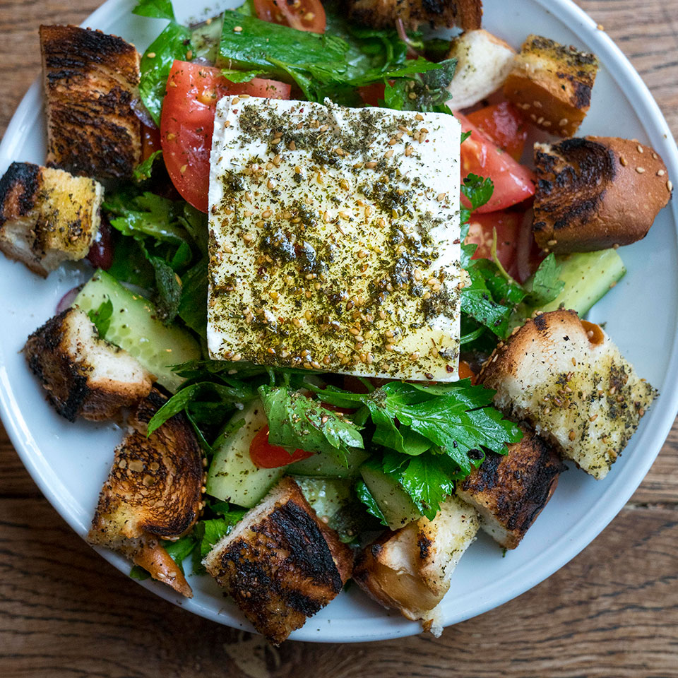 Cucumbers, tomato, parsley and feta are the basics of an Israeli salad, which is as common at breakfast as at any other meal. Here, fluffy challah croutons make the dish a sort of mash-up of the Lebanese bread salad fattoush, made with pita, and a Tuscan panzanella. It's just the kind of cross-pollination modern Israeli food is known for. And for you, it's a healthy meal that's ready in 25 minutes!