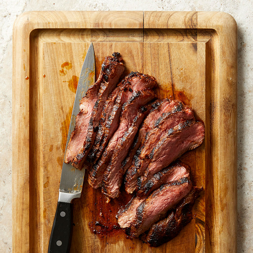 This easy grilled flank steak gets its flavor from two smoky ingredients--paprika and chipotle--rather than spending hours in a smoker. For a quick and healthy weeknight dinner, grill your favorite vegetables alongside the steak and voilà! Dinner's done. Source: EatingWell Magazine, May 2019