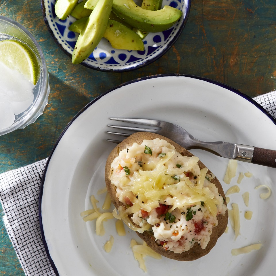 Stuffed baked potatoes are a great family-friendly weeknight supper. Here we stuff them with fresh cilantro, salsa and Jack cheese for lots of flavor and cook them in the microwave to make them quick and easy. Round out the meal with a simple avocado salad.