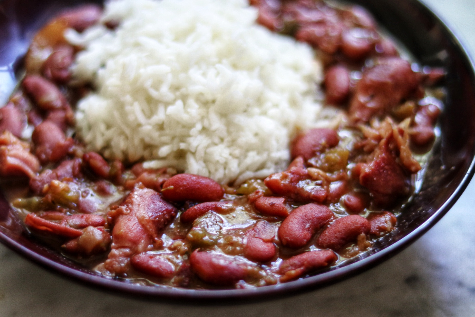 """Diana71 shares this family recipe, saying, """"This pressure cooker recipe has been converted from a family recipe that we've used for 40+ years. Our family had come across it while in New Orleans when I was a little girl. From what I remember, red beans and rice were always made at home on Mondays using leftover pork bones from the weekend meals. It's deliciously flavorful and can be made as spicy as you'd like. I hope you love it as much as my own family does."""" Reviewers agree, awarding it solid 5-star ratings."""