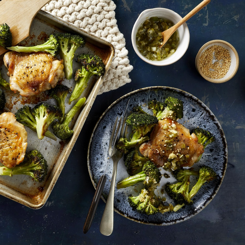 In this healthy sheet-pan chicken recipe, meaty bone-in chicken thighs and broccoli florets are tossed with sesame oil and roasted on the same pan for a delicious and easy dinner with minimal cleanup. While the chicken and broccoli cook, whip together the simple scallion-ginger sauce. The sauce would also be wonderful spooned over salmon, tofu or grain bowls; it is easily doubled or tripled! Source: EatingWell.com, April 2019