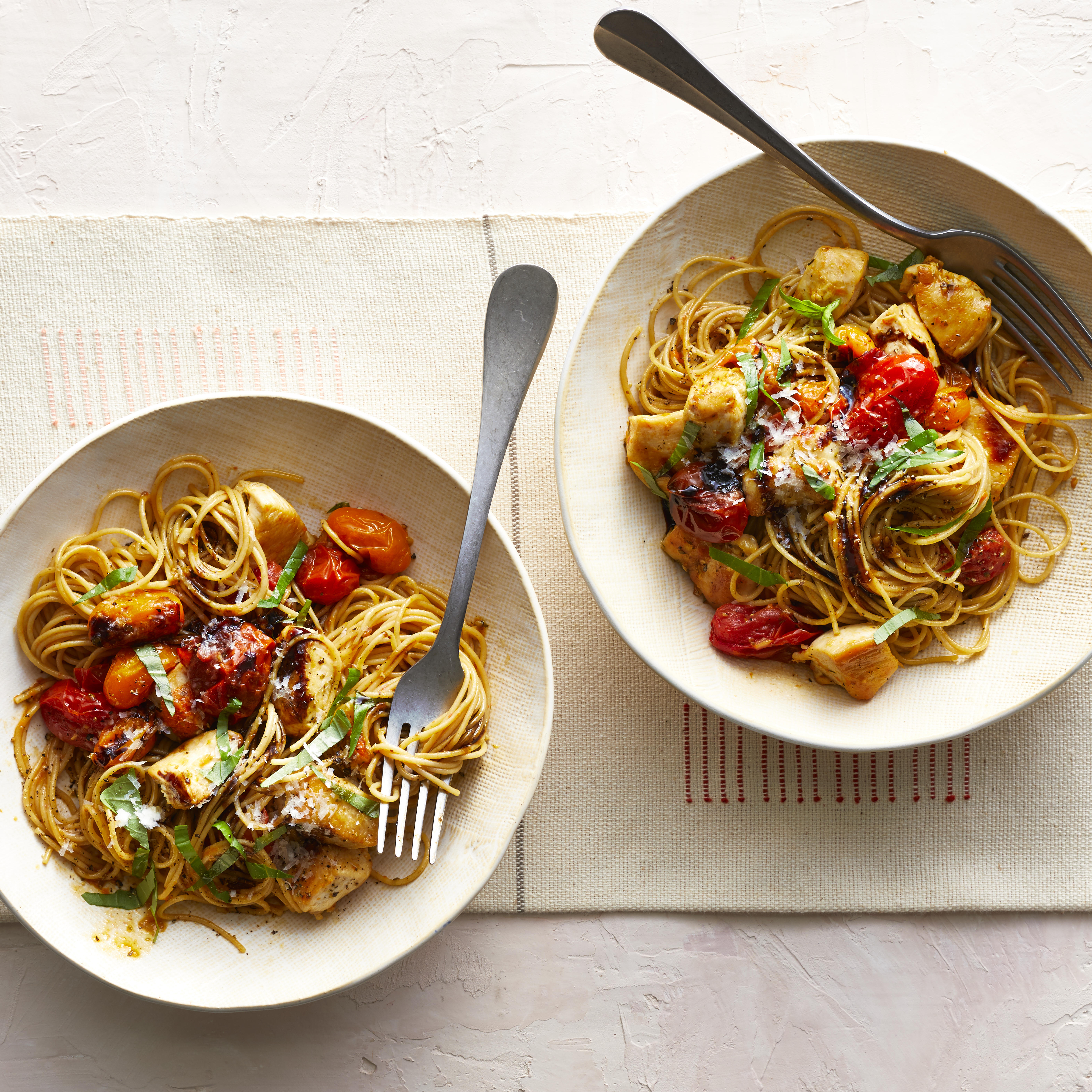 This healthy chicken pasta recipe is jazzed up with traditional bruschetta toppers, including cherry tomatoes, garlic and basil. Multicolored cherry tomatoes look pretty, but you can use all one color of tomato too. Either way, you've got an easy weeknight dinner that's ready in 25 minutes. We've called for spaghettini (thin spaghetti) in this recipe, but feel free to use your favorite shape of pasta. Source: EatingWell.com, April 2019