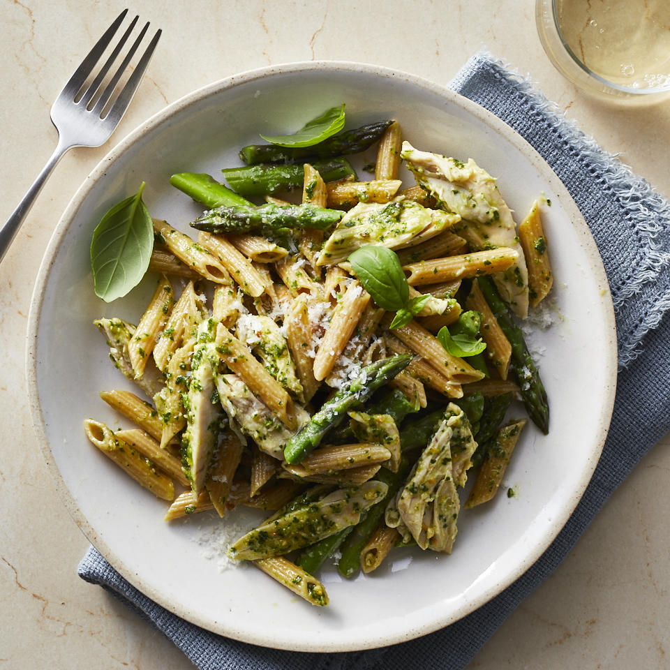 This healthy chicken pesto pasta is easy to make thanks to convenience ingredients like rotisserie chicken and store-bought pesto. The addition of fresh asparagus--which is cooked in the same pot as the pasta--brightens up the look and the flavors of this family-friendly and easy one-pot dinner. Fresh basil, if you have it on hand, is a nice finishing touch. Source: EatingWell.com, April 2019