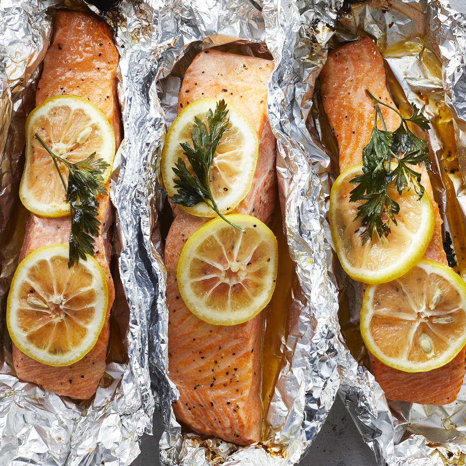 We're willing to bet that this easy grilled salmon in foil recipe will become a regular in your weeknight dinner rotation. Cooking fish in foil keeps it super-moist, plus you don't have to worry about the fish sticking to the grill. Butter, lemon pepper and fresh parsley perk up the flavors for this versatile main course. Cook some vegetables, such as asparagus, zucchini and corn, alongside the fish packets for a healthy dinner that's ready in less than 30 minutes. Source: EatingWell.com, April 2019