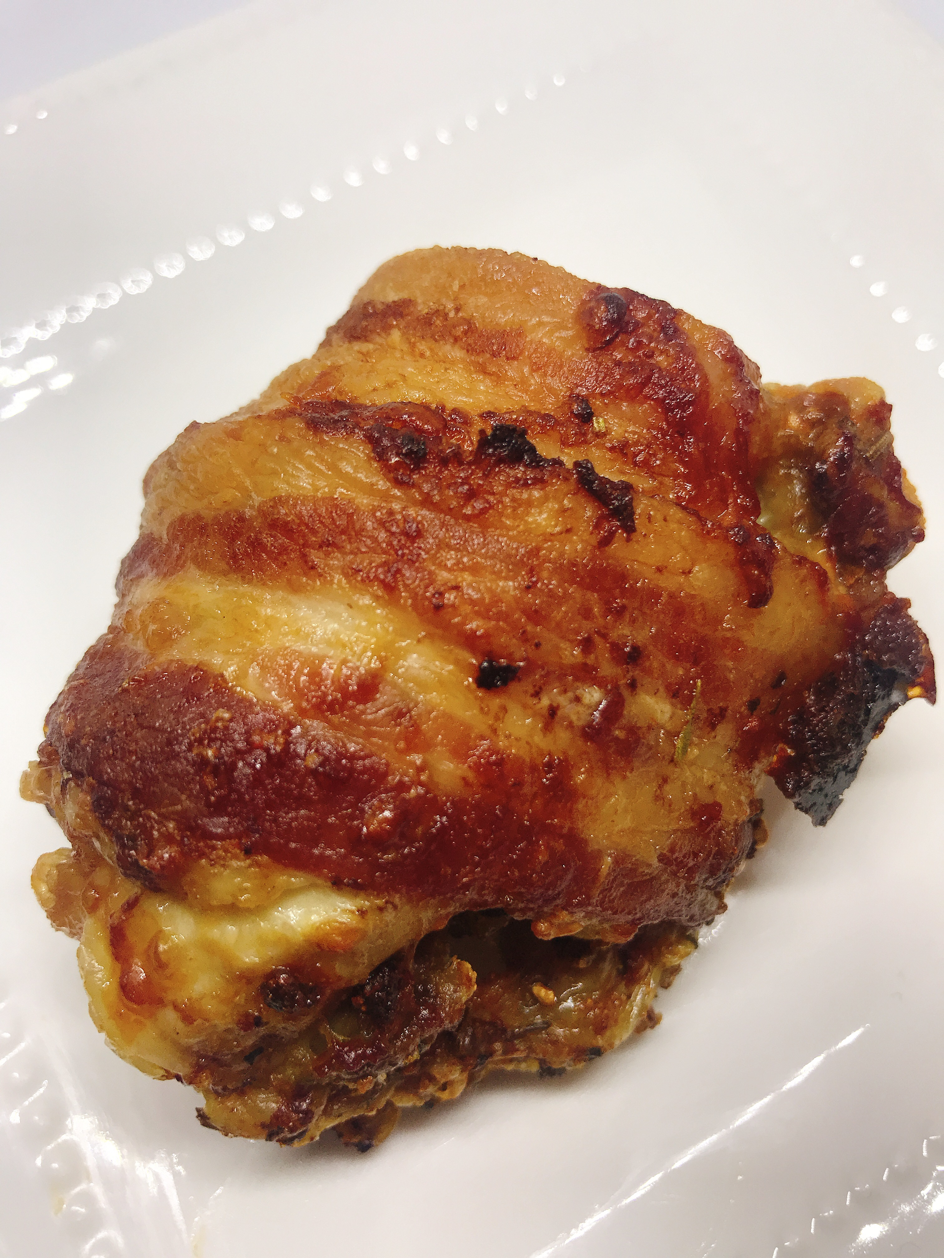 Air Fryer Bacon-Wrapped Chicken Thighs thedailygourmet