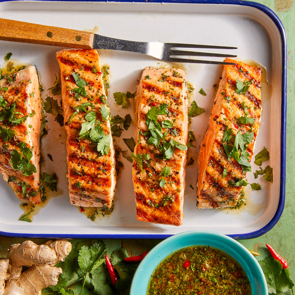 Ginger, fish sauce and honey combine to create a delicious basting sauce in this easy grilled salmon recipe. Look for Thai red chiles in the produce section of your grocery store, or use a green or red jalapeño instead. Not only is this salmon dish delicious, it also takes just 25 minutes to prepare, making it the ideal centerpiece for a healthy weeknight dinner. Source: Diabetic Living Magazine, Summer 2019