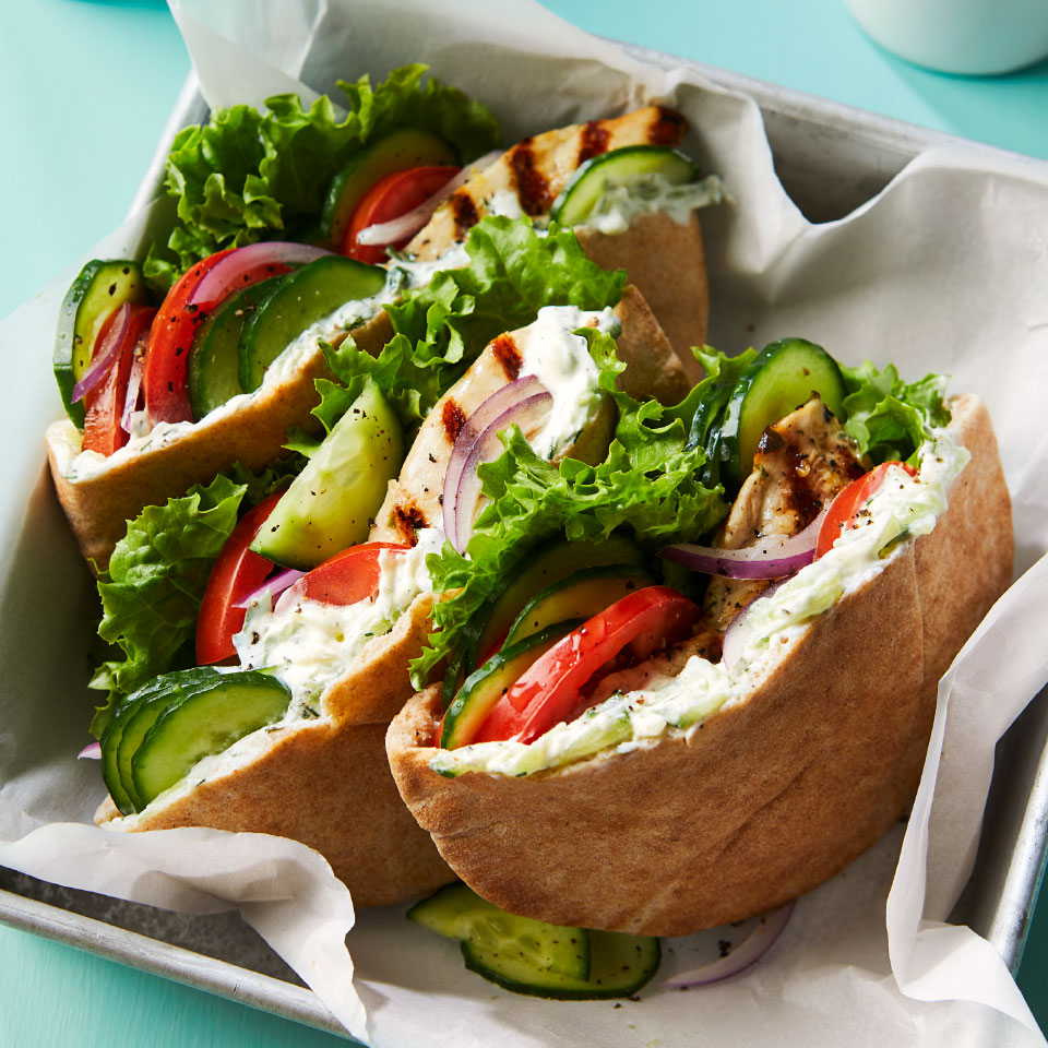 Cucumbers do double duty in this healthy Greek chicken pita recipe--they're grated to lend a refreshing flavor to the quick cucumber-yogurt sauce and sliced to provide cool crunch tucked into the pita. Serve these Mediterranean sandwiches for a healthy dinner or light lunch. Source: Diabetic Living Magazine, Summer 2019