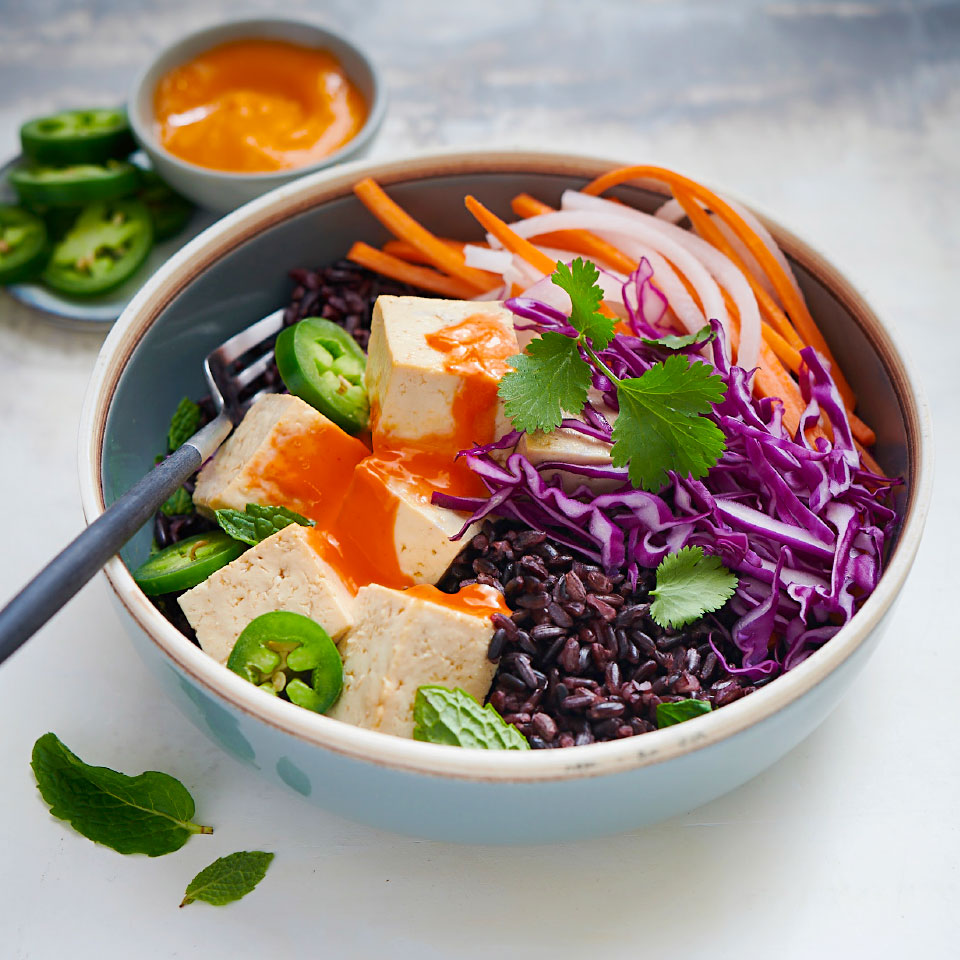 For this easy dinner recipe, we've taken inspiration from the popular Vietnamese banh mi sandwich, but lost the bun to make room for one of our favorite whole grains: black (aka forbidden) rice. To make these healthy grain bowls vegetarian, simply use additional tamari in place of the fish sauce.