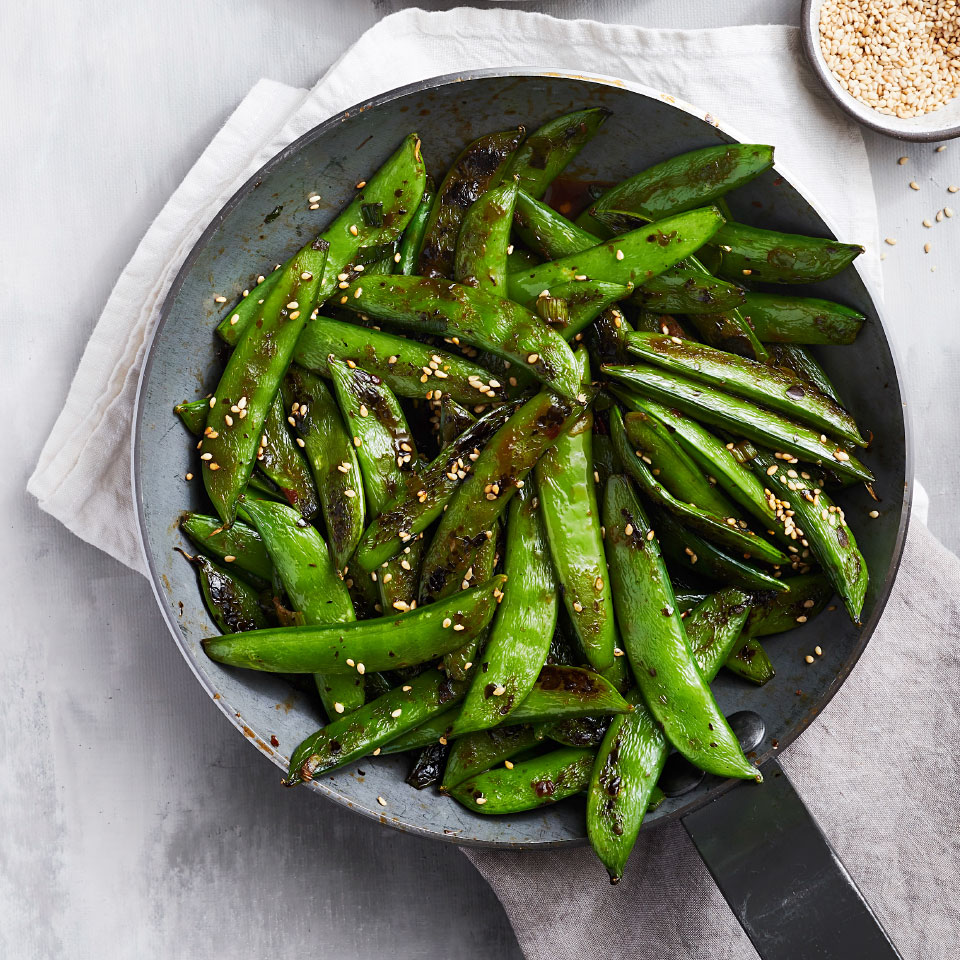 Be sure to let these sugar snap peas get some at-the-edge-of-burnt color in the skillet. It's the secret to the knockout flavor of this easy and healthy side dish. Source: EatingWell Magazine, June 2019