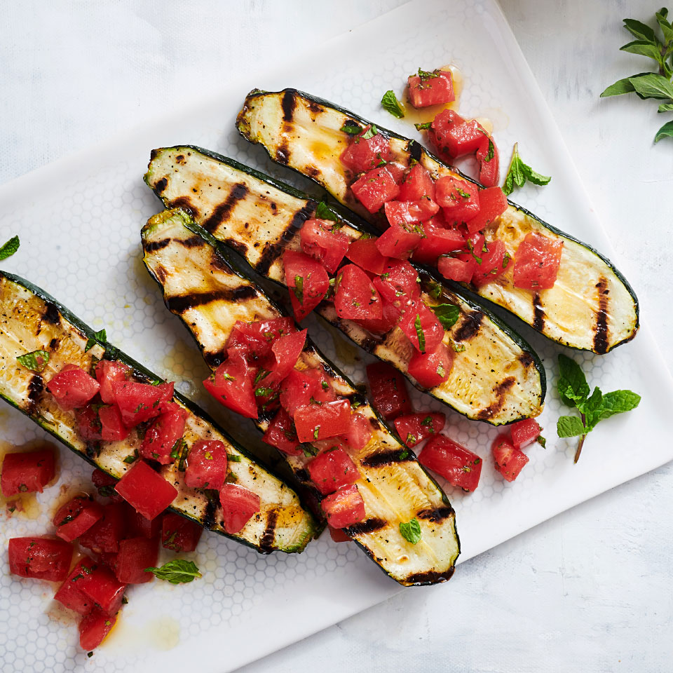 This grilled zucchini recipe is perfect for summertime bumper crops of zucchini. The tomato-mint relish would be great on all sorts of grilled vegetables. Source: EatingWell Magazine, June 2019