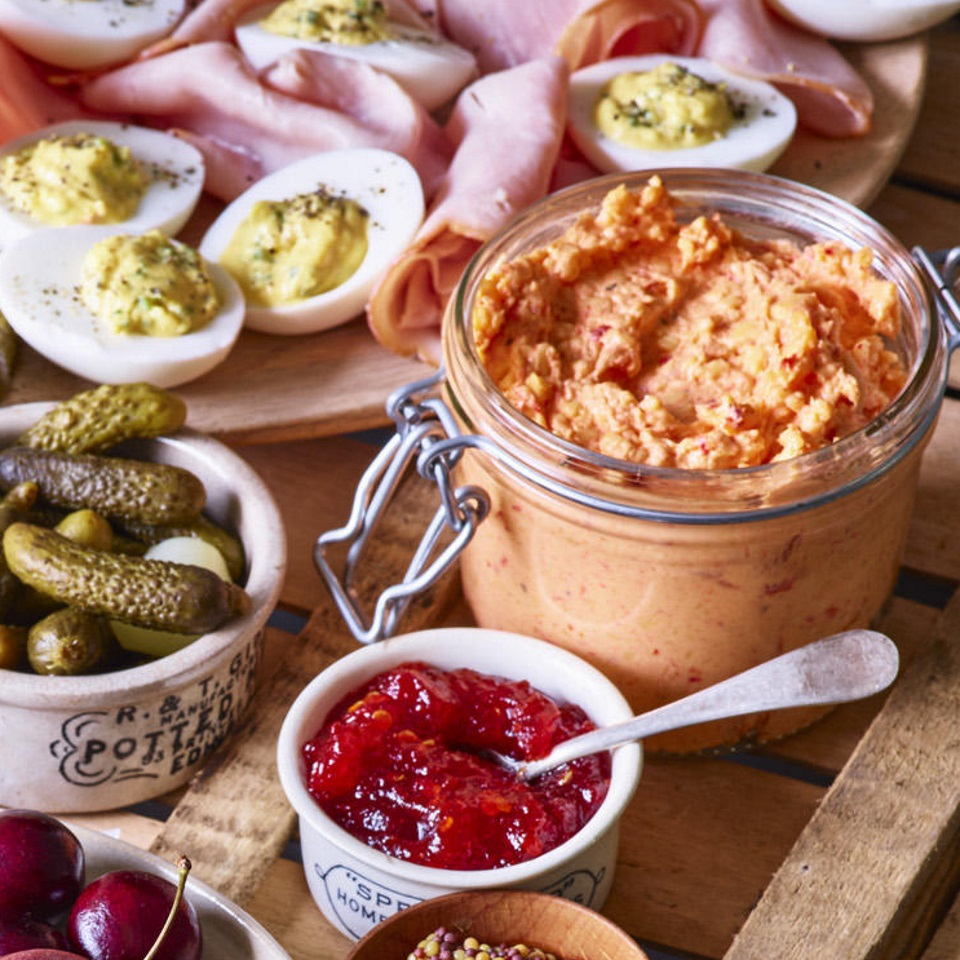 Aleppo pepper, a mild and fruity chile, is unusual yet a good fit for pimiento cheese in this easy twist on the classic Southern cheese dip. Ancho chile or even hot sauce works as well.
