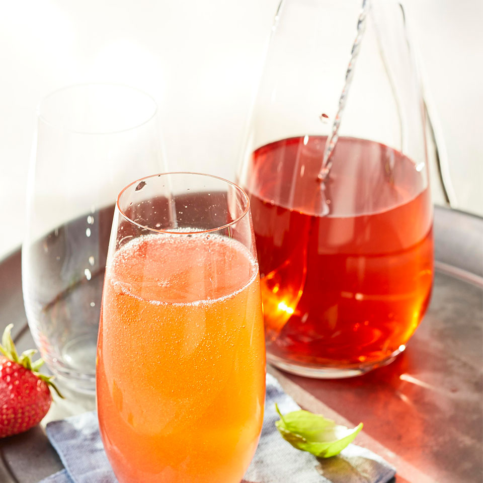 You can easily multiply this strawberry shrub mocktail recipe to serve a whole party: just muddle the strawberries, basil and lemon in a pitcher, then vigorously stir in the shrub and ice. Top each serving with seltzer. Source: EatingWell Magazine, June 2019