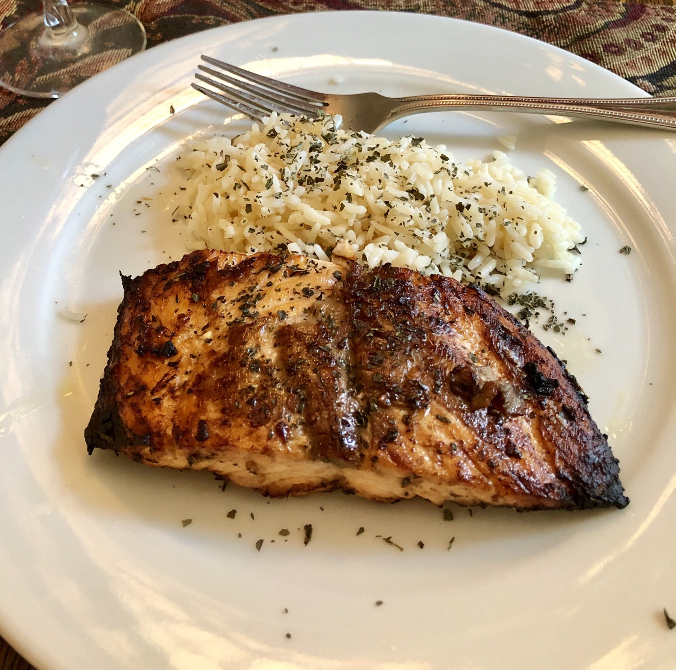 """Marinate salmon fillets for just 10 minutes in balsamic vinegar,聽 garlic, olive oil, fresh cilantro and basil. Broil on both sides, brushing occasionally with the sauce, until the salmon is easily flaked with a fork. """"Both my boyfriend and myself really loved this marinade,"""" says Kilyth. """"It works just as well on swordfish and is so quick and easy that I will definitely make this again."""""""