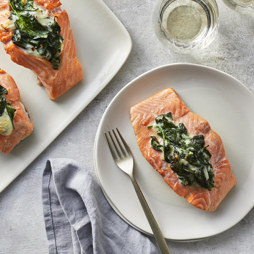 For this easy baked salmon recipe, we've stuffed salmon fillets with a luscious creamed spinach mixture for a main and side in one dish. It all adds up to a healthy dinner that's elegant, simple and delicious--and ready in 30 minutes. Wider fillets work best for this salmon recipe because they're easier to stuff than the skinny ones. You could also serve the creamed spinach on the side if you don't feel like stuffing the salmon. Source: EatingWell.com, May 2019
