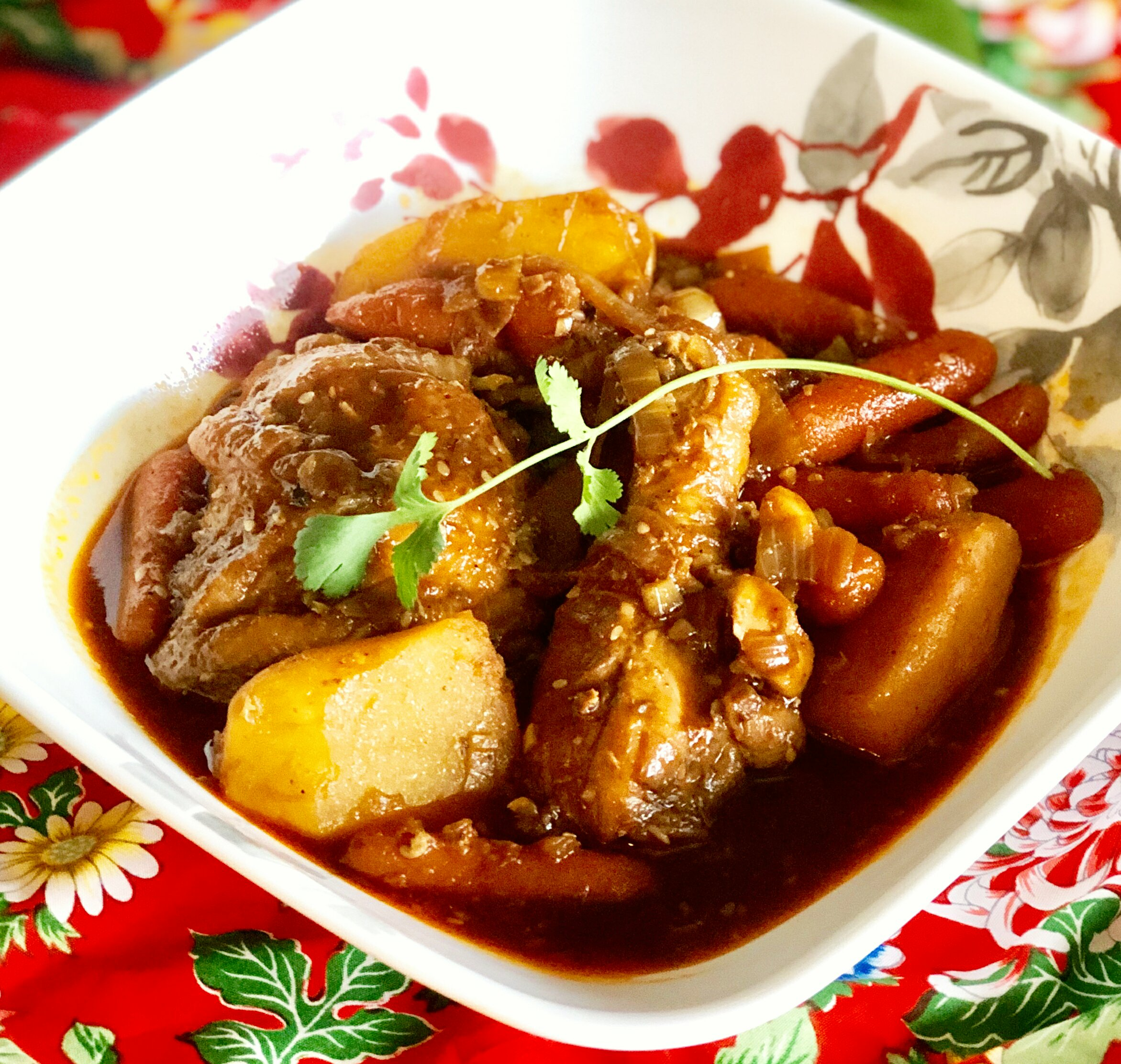 """""""This Korean chicken main dish with potatoes, onions, and carrots is served over a bed of rice,"""" says Mark Darder. """"Seasoned with soy sauce, sesame seeds, and, of course, garlic."""""""