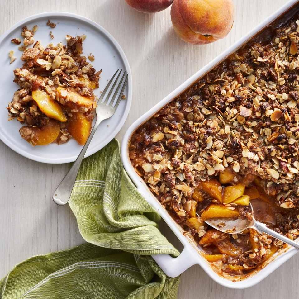 The buttery, crunchy topping for this easy gluten-free peach crisp is made with almond flour and oats instead of wheat flour, and sliced almonds add additional crunch. Make this crisp at the height of summer when fresh peaches are at their best. Served as it is or with a dollop of vanilla ice cream, it's sure to be a crowd-pleasing summer dessert. Source: EatingWell.com, May 2019