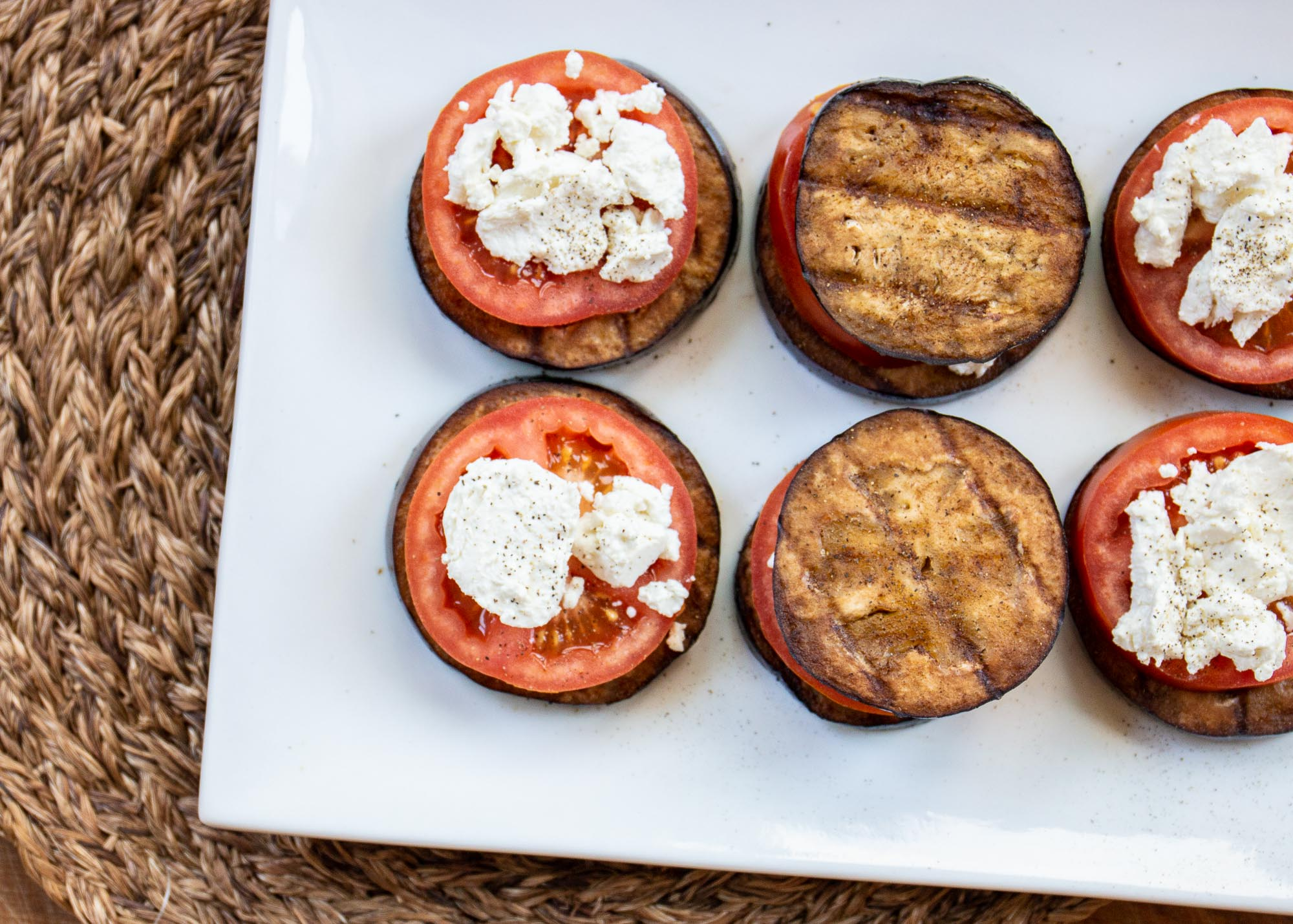 """These vegetarian stacks of grilled eggplant, tomatoes, and goat cheese, make for """"a delicious, no fuss appetizer,"""" says recipe submitter Bubba's Mom. We think it'll also go well over a grilled crostini topped with pesto."""