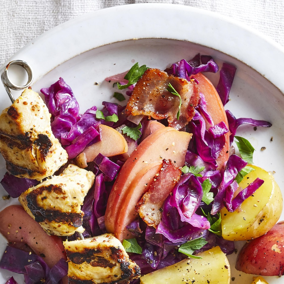 This warm apple and cabbage slaw gets bright flavor from apple-cider vinegar and a salty, savory punch from bacon. Try this easy side dish with chicken kebabs for a quick and healthy dinner.